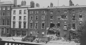 British Lancia armoured police vehicles outside the wreckage of the Hammond Hotel in O'Connell Street, Dublin during the Irish Civil War in July 1922. Photograph: Brooke/Topical Press Agency/Getty Images